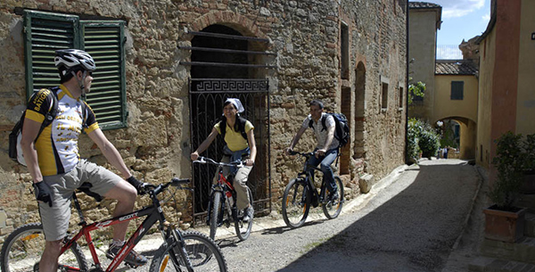 Cyclists exploring local Tuscan villages at Adler Thermae