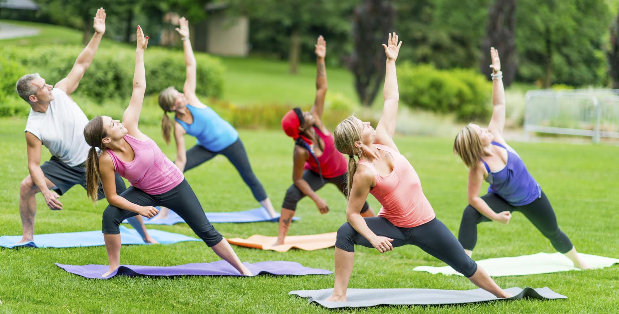 Group yoga class outside