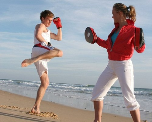 One-on-one kickboxing session on the beach