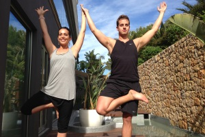 Paul practising yoga with teacher Ayda Ellis at Aguas de Ibiza