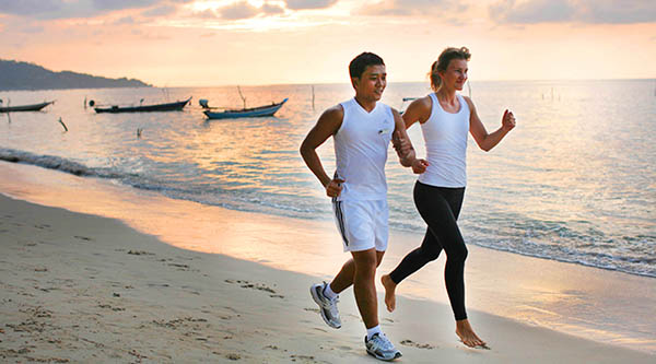 Personal trainer beach jogging at Samahita