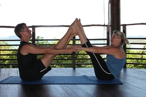 Samantha and Paul practising yoga at Kamalaya, Thailand