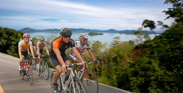 Triathletes cycling through exotic Thailand at Thanyapura