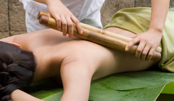A bamboo massage at The Farm