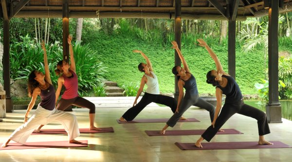 Group yoga class on holiday at The Farm