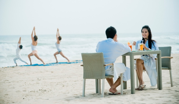 Dine together on the beach at Fusion Maia