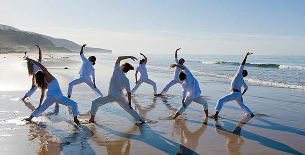 A yoga class on the beach at Paradis Plage