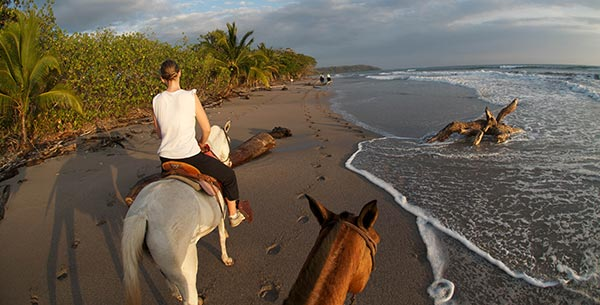 horse riding on the beach at florblanca