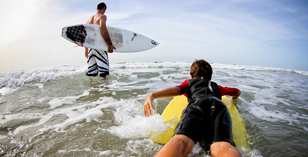 Learn to surf the waves at Paradis Plage