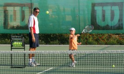 Children's tennis coaching lesson at Aphrodite Hills in Cyprus