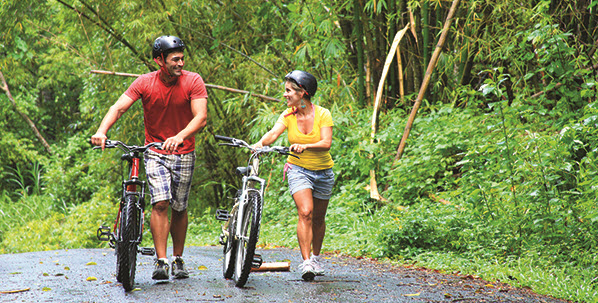 couple biking in thailand